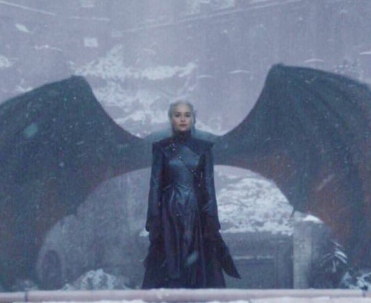 Queen Dany with Drogon behind her making it appear as though she has dragon wings.