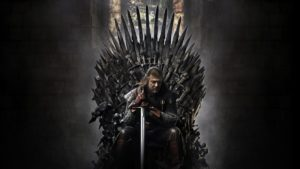 Ned Stark sitting on the iron throne.